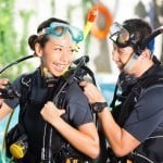 Asian people at the diver Course in diving school in wetsuit wit